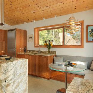 Idéer för att renovera ett litet funkis kök med matplats, med vita väggar, betonggolv och grått golv