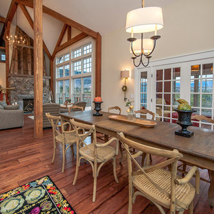 Example of a mid-sized mountain style medium tone wood floor kitchen/dining room combo design in Burlington with white walls
