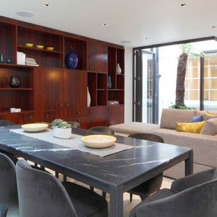 This is an example of a medium sized contemporary dining room in London with grey walls and white floors.