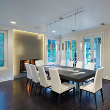 Contemporary Dining Room by Caisson Studios