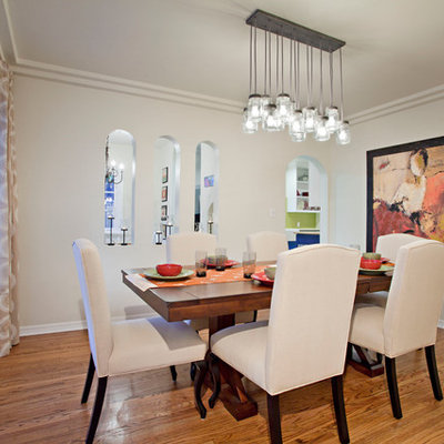 Inspiration for a mid-sized contemporary medium tone wood floor enclosed dining room remodel in Los Angeles with white walls and no fireplace