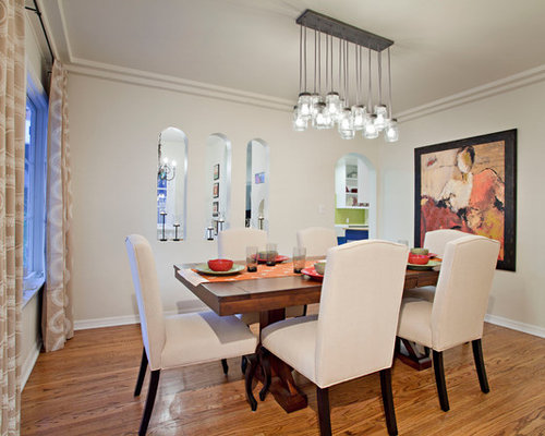 Inspiration for a mid sized contemporary medium tone wood floor enclosed dining  room remodel in Casual Dining Rooms Houzz