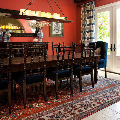 Dining room - mediterranean dining room idea in Los Angeles with red walls