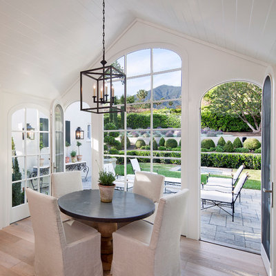Cottage light wood floor dining room photo in Santa Barbara with white walls