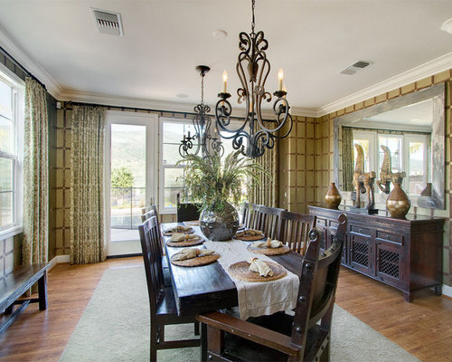 Example Of A Trendy Dark Wood Floor Enclosed Dining Room Design In San Diego