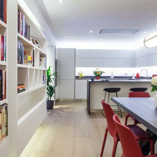 Design ideas for a medium sized contemporary kitchen/dining room in London with light hardwood flooring and beige floors.