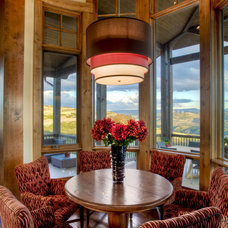 Rustic Dining Room by Cameo Homes Inc.