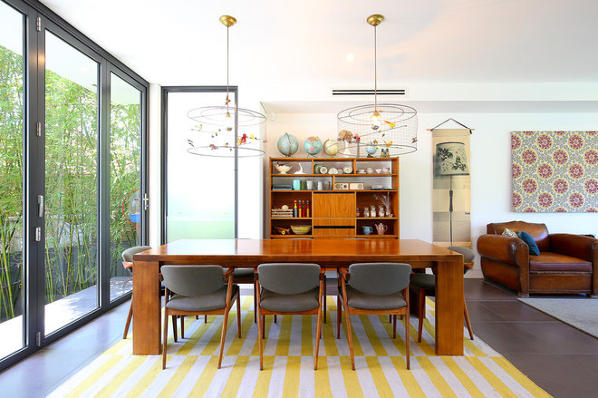 Midcentury Dining Room by MadeComfy