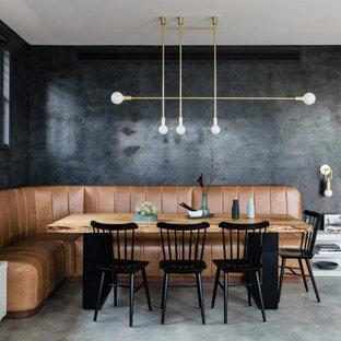 Idee per una sala da pranzo aperta verso il soggiorno minimal con pareti grigie, pavimento in cemento e pavimento grigio