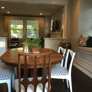 Inspiration for a mid-sized 1950s laminate floor and brown floor kitchen/dining room combo remodel in Other with gray walls and no fireplace