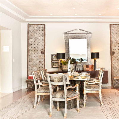 Dining room - contemporary dark wood floor dining room idea in San Francisco with white walls