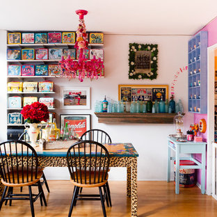Dining room - eclectic medium tone wood floor dining room idea in New York with multicolored walls