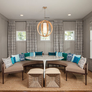 Inspiration for a beach style dining room remodel in Charleston with gray walls