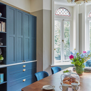 Photo of a victorian dining room in London with multi-coloured walls and medium hardwood flooring.
