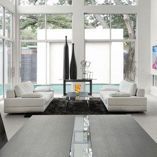 Diseño de comedor de cocina minimalista, grande, con paredes blancas, suelo de baldosas de porcelana y suelo blanco