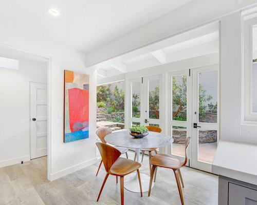 Example Of A Coastal Light Wood Floor And Beige Floor Kitchen/dining Room  Combo Design