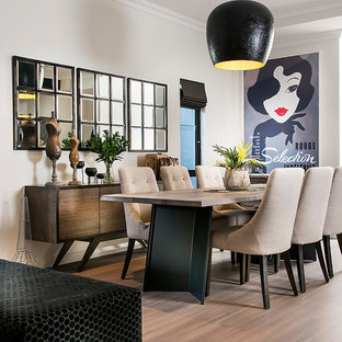 This is an example of a contemporary open plan dining in Perth with grey walls, medium hardwood floors and brown floor.