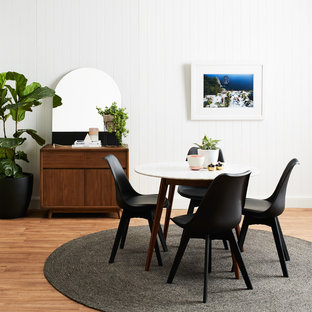 Mid-sized contemporary dining room in Sydney with white walls, vinyl floors, no fireplace and brown floor.