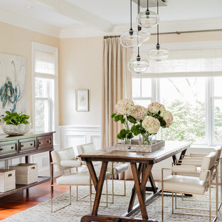 Example of a large classic medium tone wood floor dining room design in Boston with beige walls