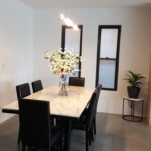 Example of a large trendy porcelain floor and gray floor great room design in Sydney with white walls, a hanging fireplace and a plaster fireplace