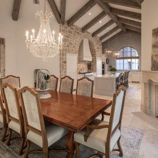 Idéer för ett medelhavsstil kök med matplats, med vita väggar, en öppen hörnspis och beiget golv