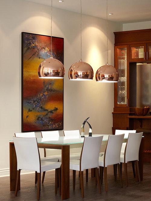 dark wood floor dining room idea in montreal with beige walls