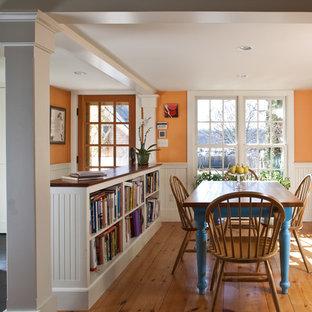 Ispirazione per una sala da pranzo chic di medie dimensioni con pareti arancioni