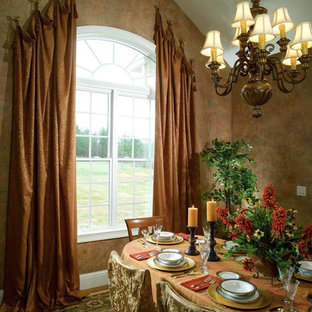 Elegant dining room photo in Atlanta with brown walls