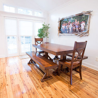 Photo of a small beach style kitchen/dining combo in Other with white walls and medium hardwood floors.