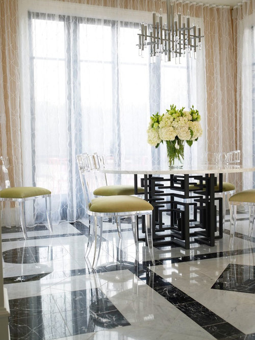 inspiration for a midsized marble floor and floor dining room remodel in