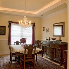 Eclectic Dining Room by Blue Sky Building Company