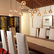 Eclectic Dining Room by Constructora Malver