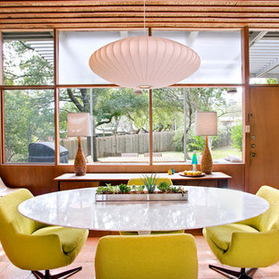 Inspiration for a large midcentury dining room in Austin.