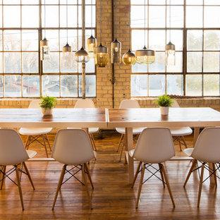 Dining room - industrial medium tone wood floor dining room idea in Minneapolis