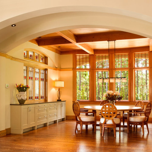 Inspiration For A Timeless Medium Tone Wood Floor Dining Room Remodel In  Charleston With Beige Walls