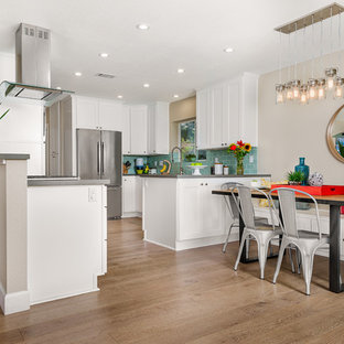 Coastal light wood floor kitchen/dining room combo photo in San Diego with beige walls and no fireplace