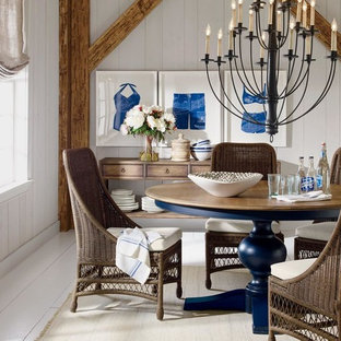 Great room - large country painted wood floor and white floor great room idea with white walls and no fireplace