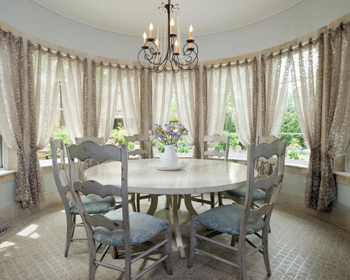 Example Of A Classic Dining Room Design In Chicago With Blue Walls