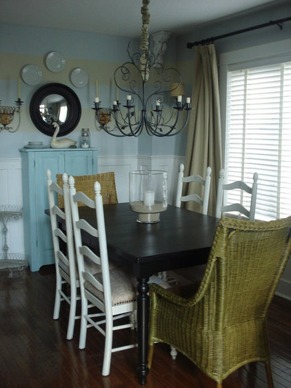Traditional Dining Room by Chris  Kauffman