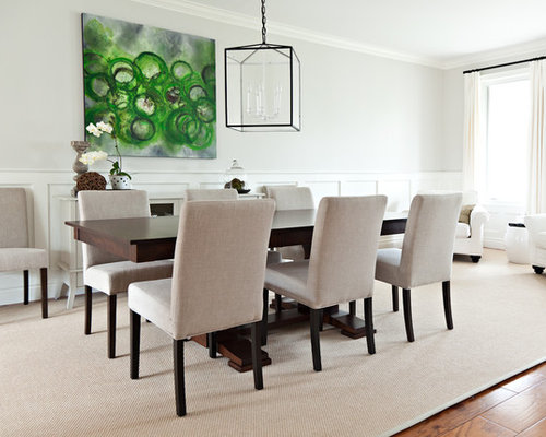 elegant dining rooms. Example of a transitional medium tone wood floor dining room design in  Toronto with white walls Elegant Dining Rooms Houzz