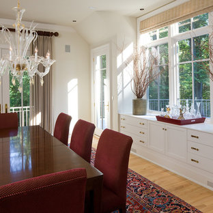 Dining room - traditional medium tone wood floor dining room idea in Baltimore with white walls