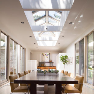 Example Of A Trendy Beige Floor Enclosed Dining Room Design In Minneapolis  With White Walls