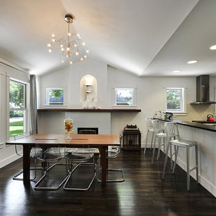 Example of a transitional dark wood floor and brown floor kitchen/dining room combo design in Austin with white walls