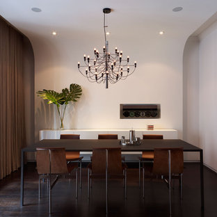 Minimalist dark wood floor dining room photo in New York with white walls