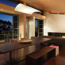Contemporary Dining Room by Charles Debbas Architecture