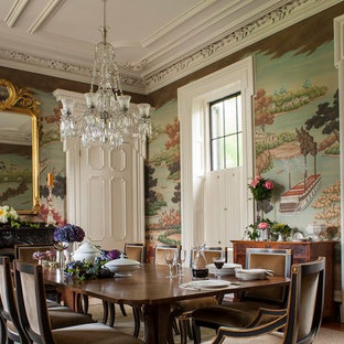 Inspiration for a victorian separate dining room in Charleston with multi-coloured walls, medium hardwood floors and a standard fireplace.