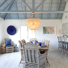 Beach Style Dining Room by Erika Bierman Photography