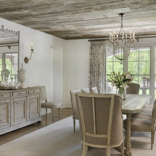 Example of a cottage chic medium tone wood floor enclosed dining room design in St Louis with gray walls and no fireplace