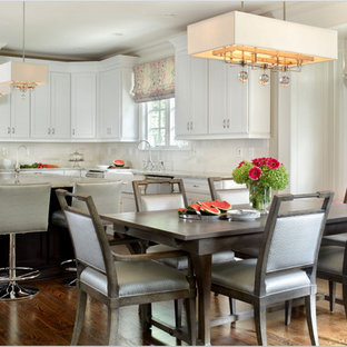 Large traditional kitchen/dining room in New York with medium hardwood flooring and grey walls.