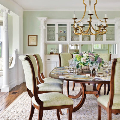 Large beach style dark wood floor enclosed dining room photo in Boston with green walls and no fireplace